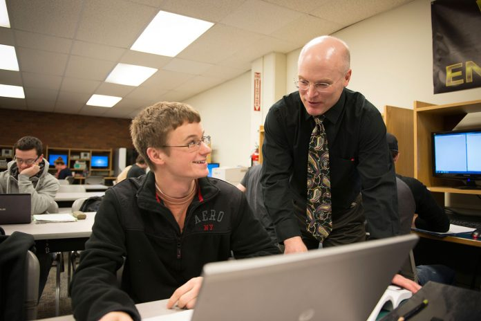 College Professor in classroom with student