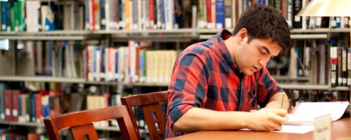 Introvert student in library