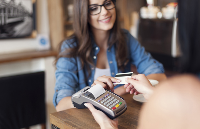 female student using a credit card