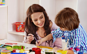 How does a family daycare help in developing the skills of children?