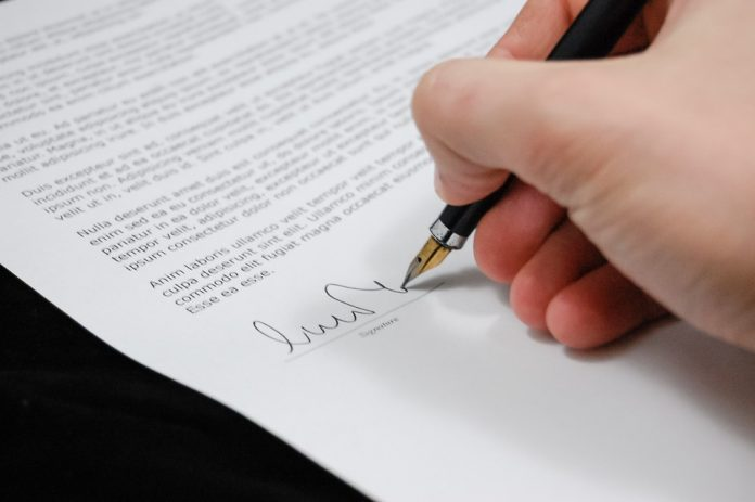 signing a paper