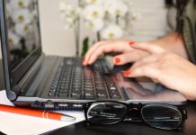 writing an essay using laptop