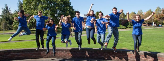 happy jumping students