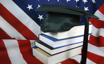 US flag, book, and graduate hat